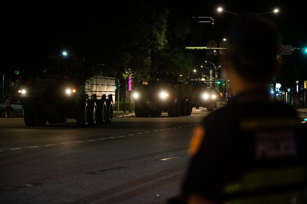 Clouded Leopard armored vehicles rumbling through the streets of Taipei early Tuesday morning.