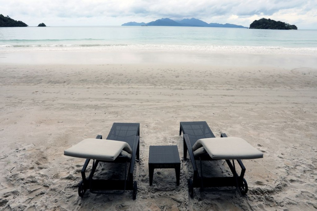 Empty chairs are seen at The Datai Langkawi resort beach, as Langkawi gets ready to open to domestic tourists from September 16, amid the coronavirus ...