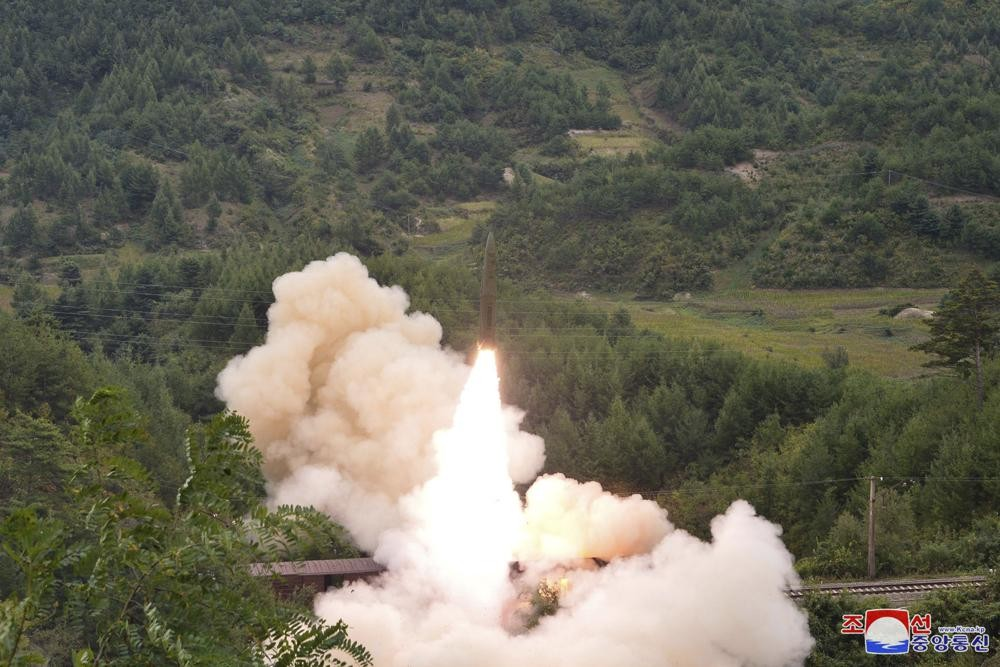 Amissile is launched from a train in an undisclosed location somewherein the mountainous wilderness of North Korea. (Korean Central News A...