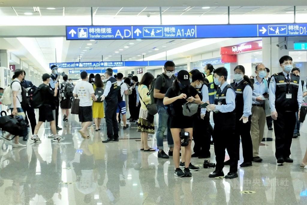 Travelers at Taiwan Taoyuan International Airport.