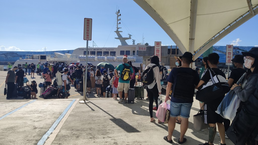Travelers waiting to board a ferry in TaitungSaturday.