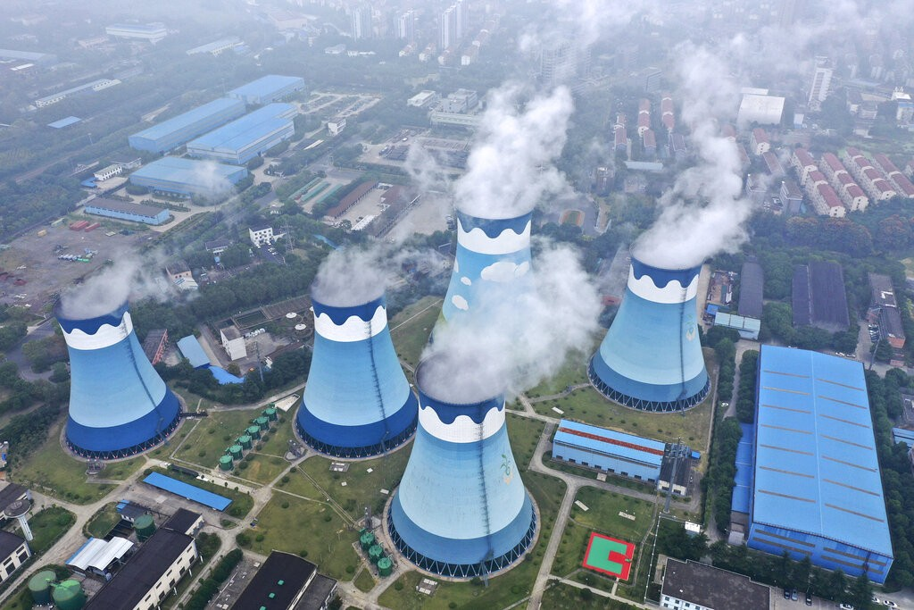 Steam billows out of the cooling towers at a coal-fired power station in Nanjing in east China's Jiangsu province on Monday, Sept. 27, 2021....
