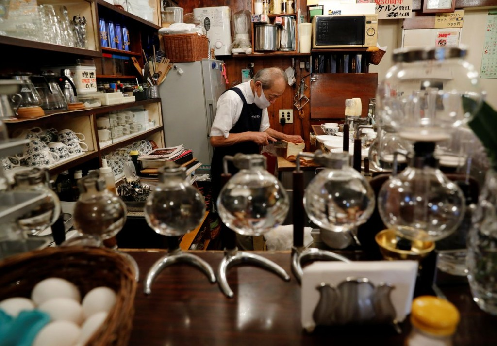 Shizuo Mori, the owner of Heckeln coffee shop makes sandwiches for customers at his shop in Tokyo, Japan, October 8, 2021. REUTERS/Kim Kyung-Hoon