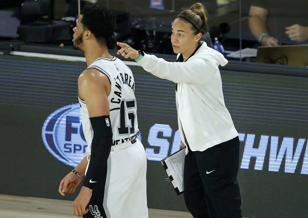 FILE - San Antonio Spurs assistant coach Becky Hammon talks with Quinndary Weatherspoon (15) during the second half of an NBA basketball game against ...