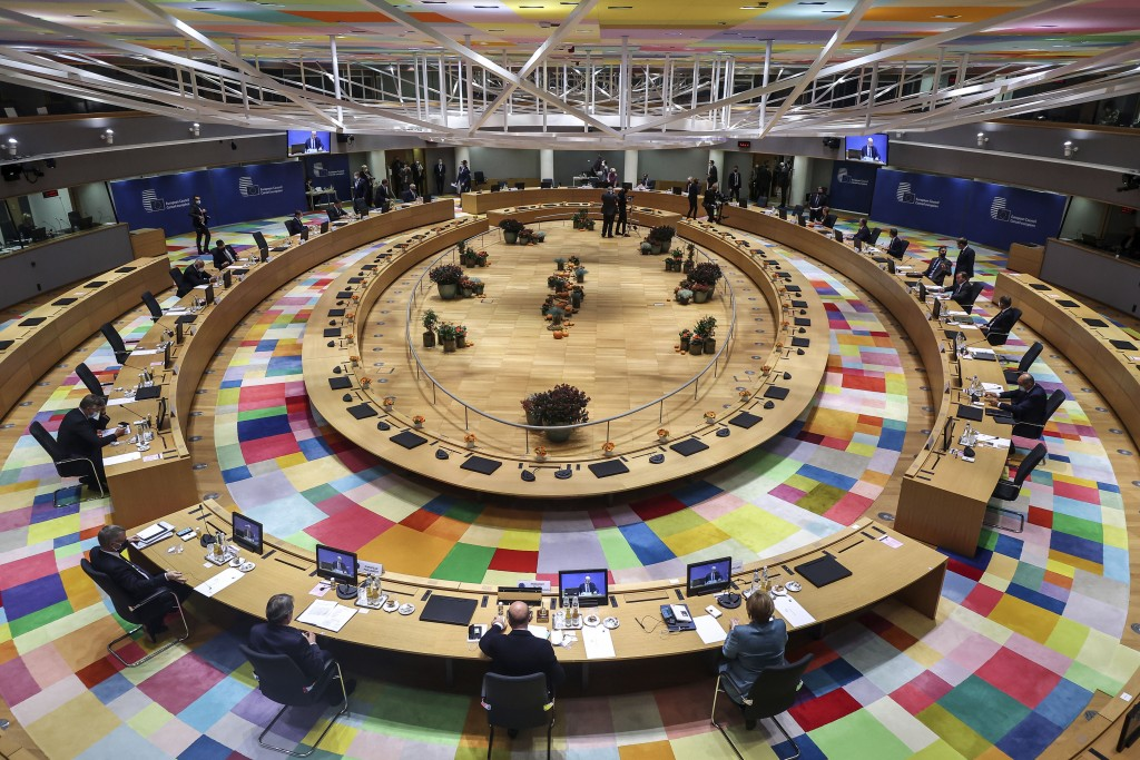 FILE - In this Thursday, Oct. 15, 2020 file photo, a general view of EU heads of state during a round table meeting at an EU summit at the European Co...