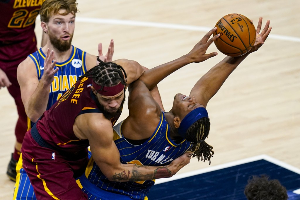Cleveland Cavaliers center JaVale McGee (6) fouls Indiana Pacers forward Myles Turner (33) as he shoots during the first half of an NBA basketball gam...