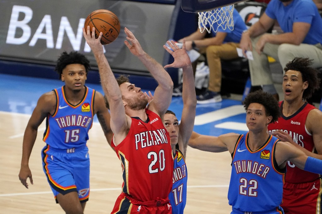 New Orleans Pelicans forward Nicolo Melli (20) shoots in front of Oklahoma City Thunder forward Josh Hall (15), forward Aleksej Pokusevski (17) and fo...