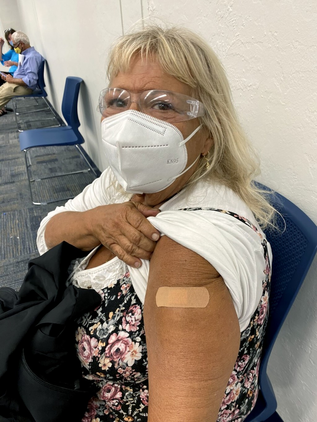 In this photo provided by Terry Beth Hadler , the 69-year-old, poses after receiving a dose of a COVID-19 vaccine on Tuesday, Dec. 29, 2020, at a Boni...