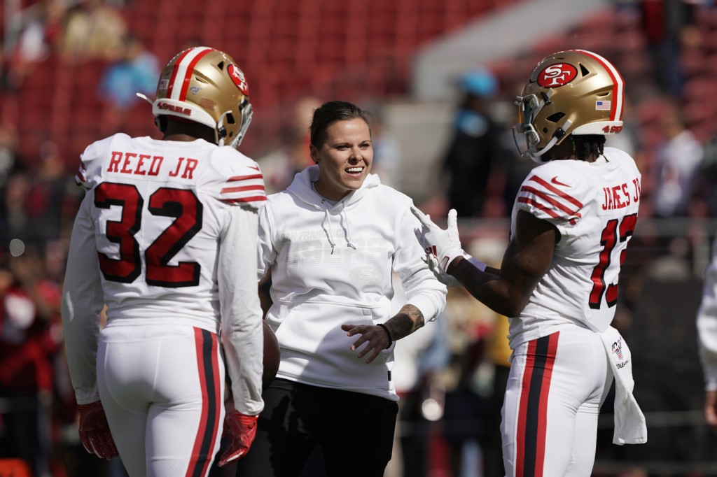 FILE - San Francisco 49ers assistant Katie Sowers talks with free safety D.J. Reed (32) and wide receiver Richie James (13) before an NFL football gam...