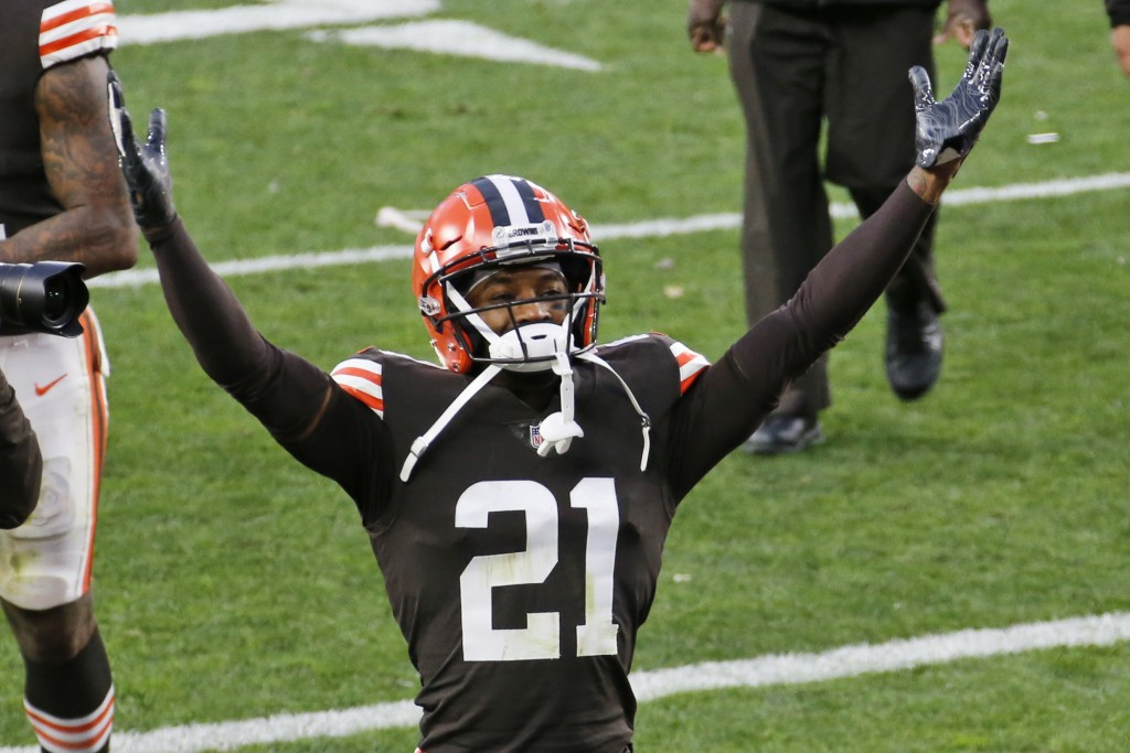 FILE - In this Sunday, Nov. 15, 2020 file photo, Cleveland Browns cornerback Denzel Ward celebrates after the Browns defeated the Houston Texans 10-7 ...