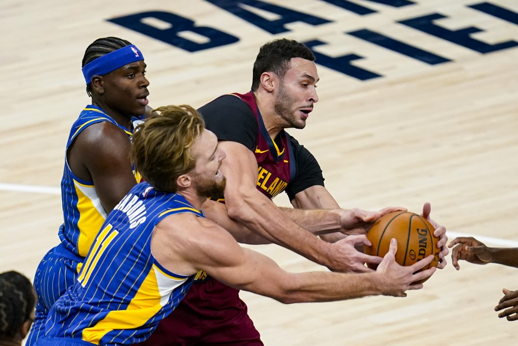 Indiana Pacers forward Domantas Sabonis (11) and Cleveland Cavaliers forward Larry Nance Jr. (22) fight for a long rebound during the first half of an...