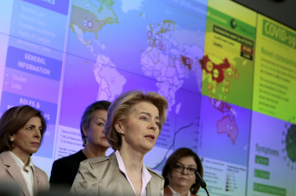 FILE - In this Monday, March 2, 2020 file photo, European Commission President Ursula von der Leyen, center, speaks during a media conference regardin...