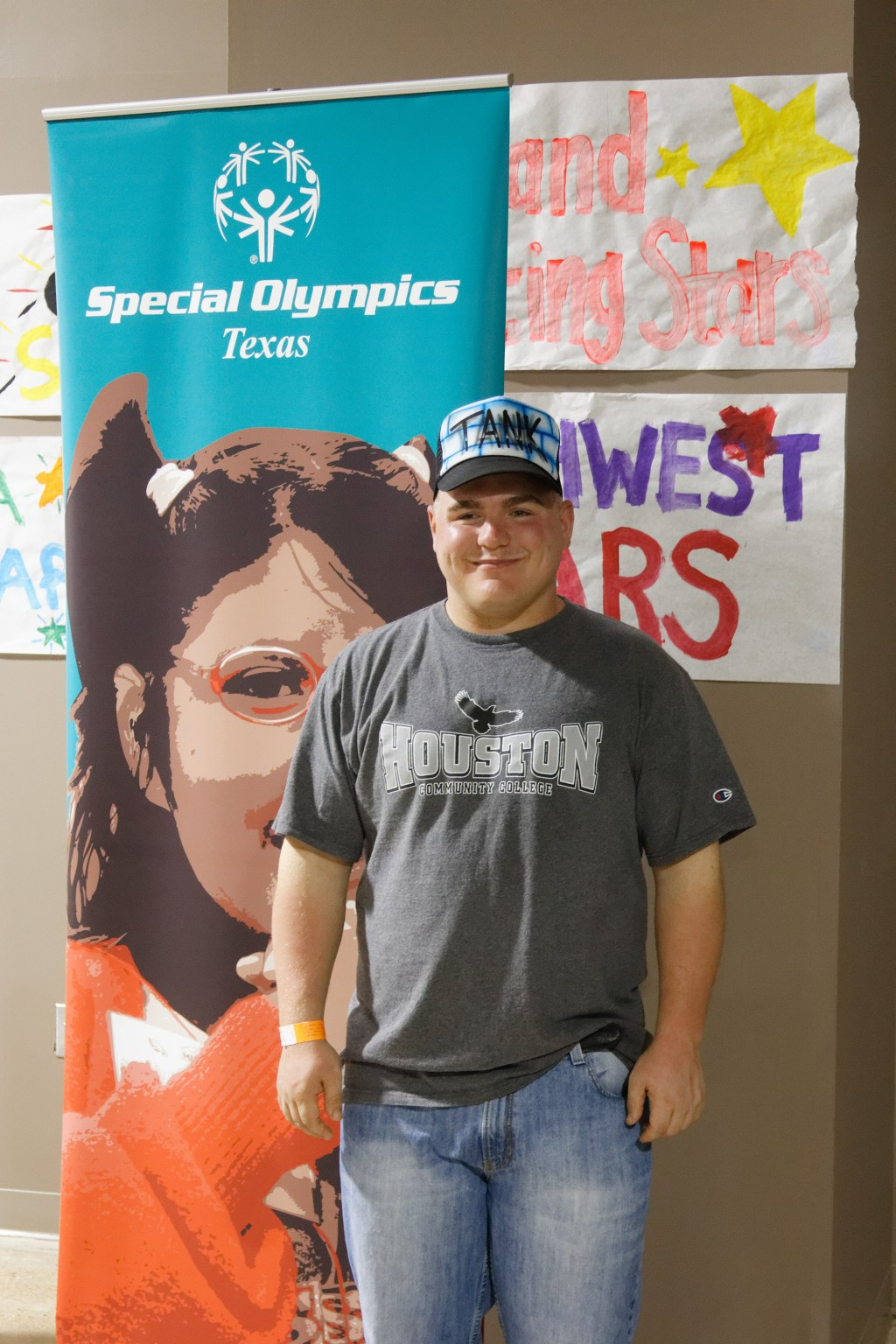 "In this photo provided by Gary Schottle, Derek ""Tank"" Schottle poses in the Athletes Village at the Texas Special Olympics in College Station, Texas, ..."