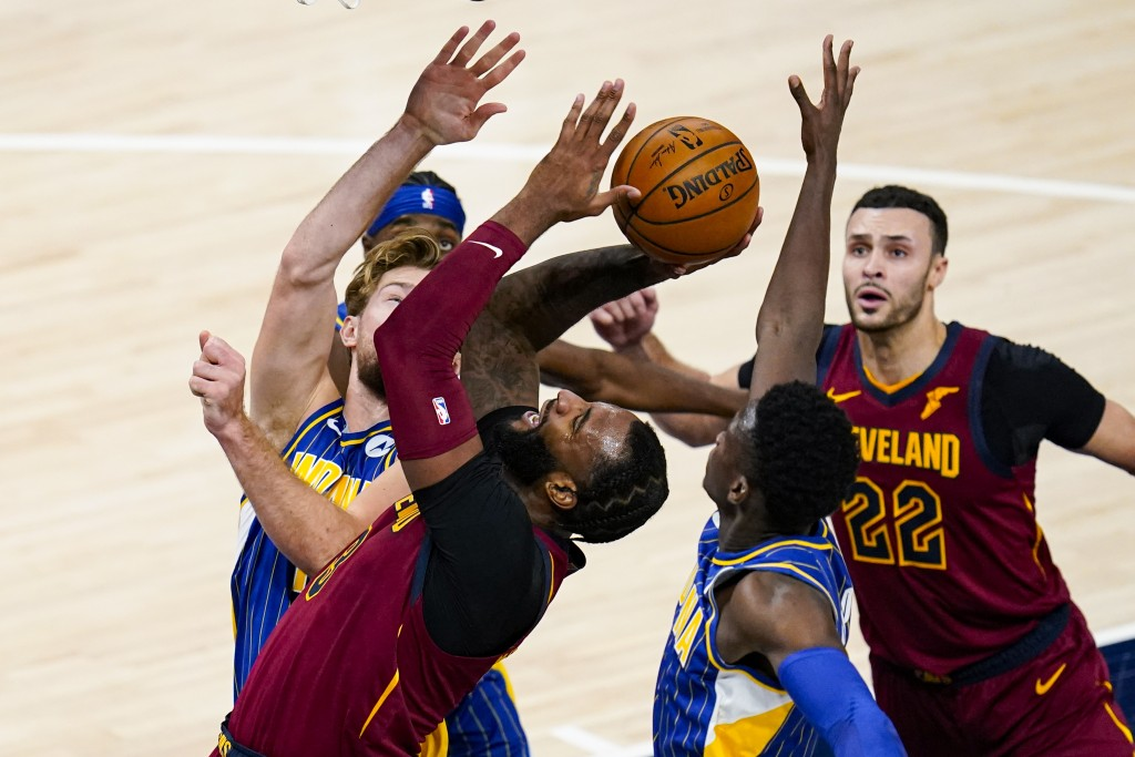 Cleveland Cavaliers center Andre Drummond (3)n shoots between Indiana Pacers forward Domantas Sabonis (11) and guard Victor Oladipo (4) during the sec...