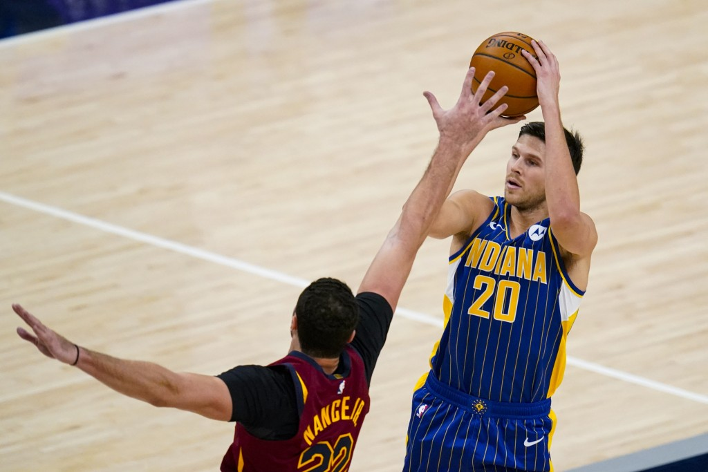Indiana Pacers forward Doug McDermott (20) is fouled on a three-point shot by Cleveland Cavaliers forward Larry Nance Jr. (22) during the first half o...