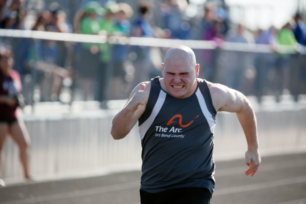 "In this photo provided by Gary Schottle, Derek ""Tank"" Schottle competes in the 100 meter dash as part of the Pentathlon at a Special Olympics track me..."