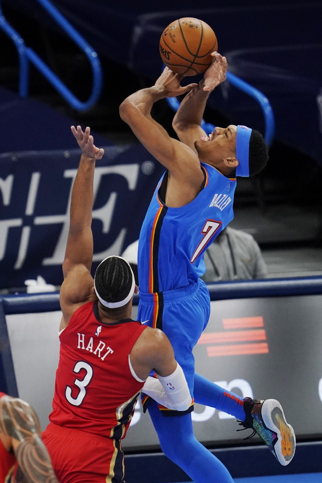 Oklahoma City Thunder forward Darius Bazley (7) is fouled by New Orleans Pelicans guard Josh Hart (3) as he shoots during the second half of an NBA ba...