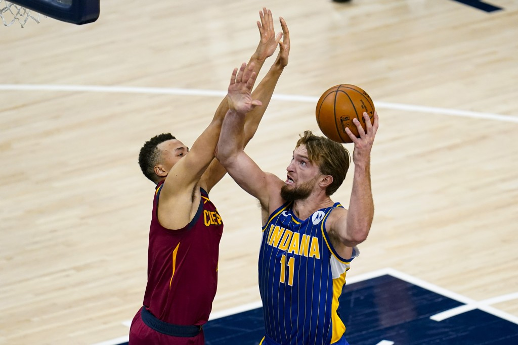Indiana Pacers forward Domantas Sabonis (11) shoots over Cleveland Cavaliers guard Dante Exum (1) during the first half of an NBA basketball game in I...