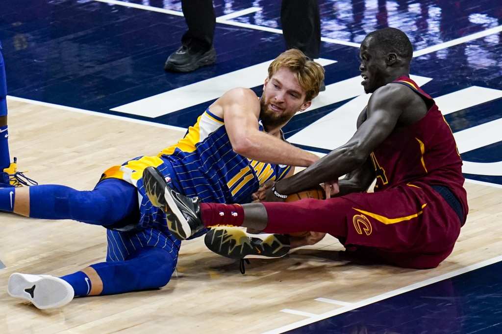 Indiana Pacers forward Domantas Sabonis (11) and Cleveland Cavaliers center Thon Maker (14) go to the floor for a loose ball during the second half of...