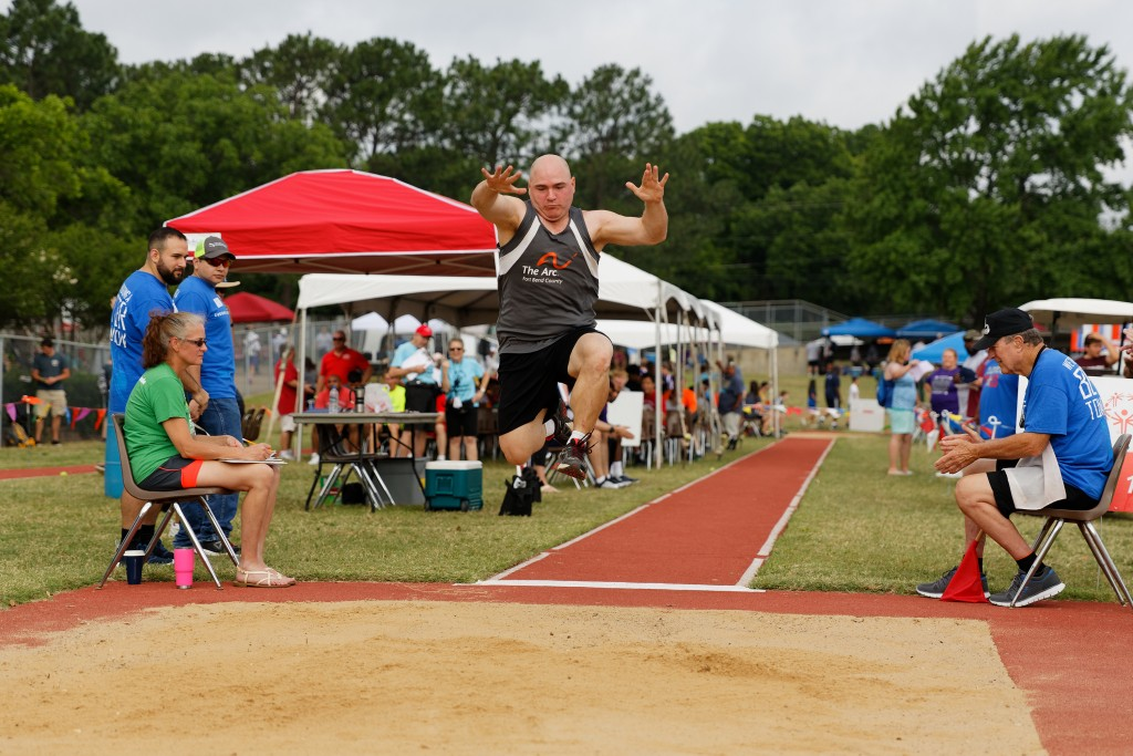 "In this photo provided by Gary Schottle, Derek ""Tank"" Schottle competes in the long jump as part of the Pentathlon competition at the Texas Special Ol..."