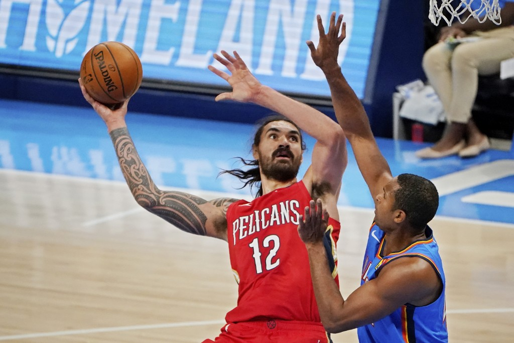 New Orleans Pelicans center Steven Adams shoots in front of Oklahoma City Thunder center Al Horford, right, during the second half of an NBA basketbal...