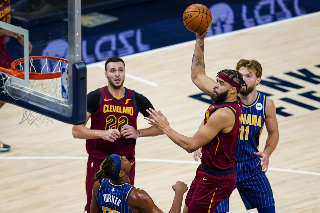 Cleveland Cavaliers center JaVale McGee (6) shoots over Indiana Pacers forward Myles Turner (33) during the second half of an NBA basketball game in I...