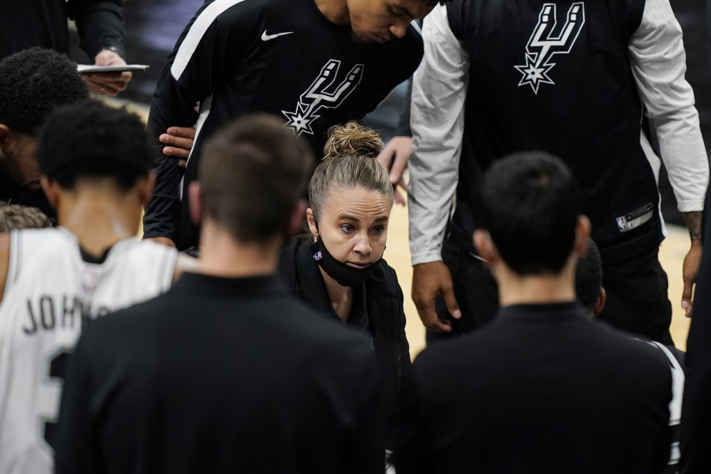 San Antonio Spurs assistant coach Becky Hammon calls a play during a timeout in the second half of the team's NBA basketball game against the Los Ange...