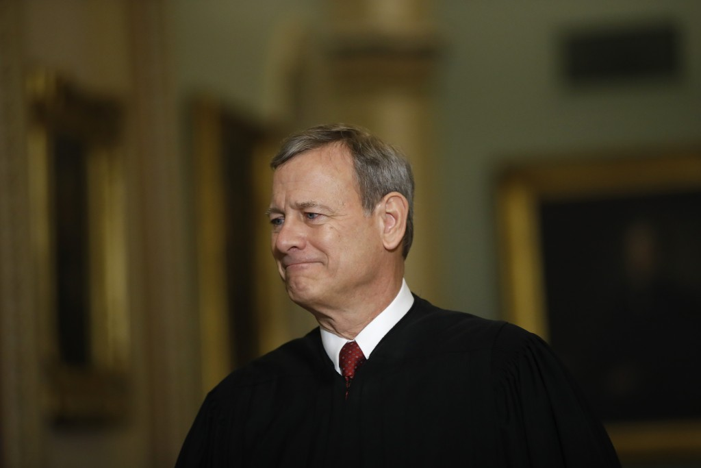 FILE - In this Jan. 16, 2020, file photo Chief Justice of the United States, John Roberts walks to the Senate chamber at the Capitol in Washington. (A...