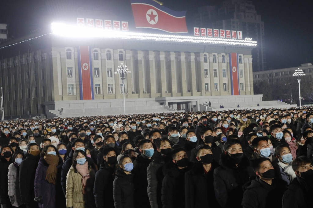 People watch the flag raising ceremony and fireworks display to celebrate the New Year,  at Kim Il Sung Square in Pyongyang, North Korea, early Friday...