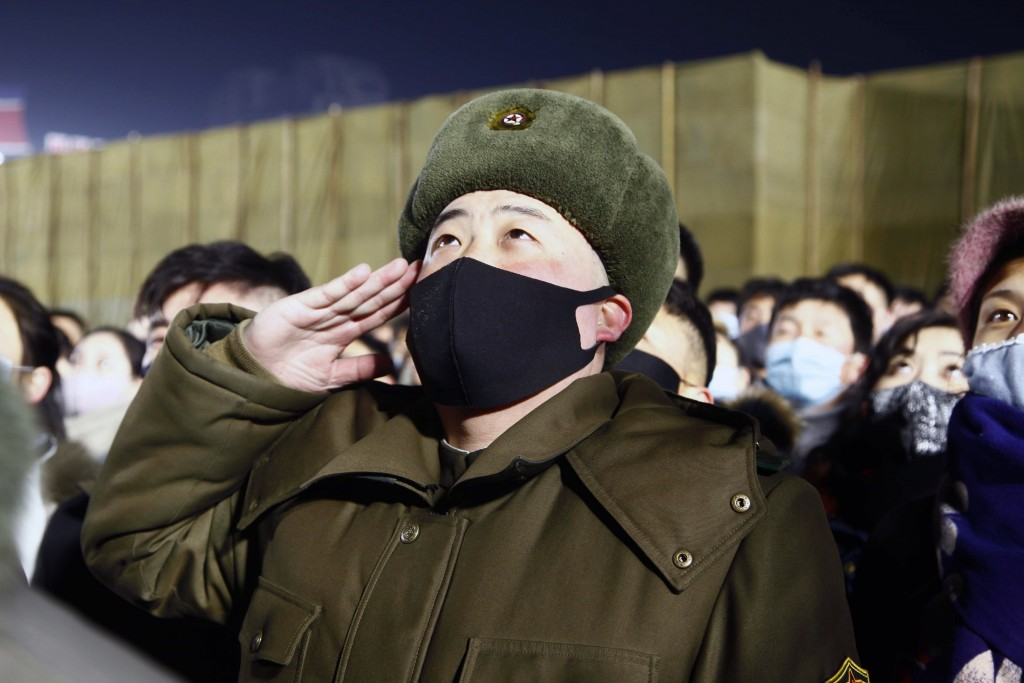 A man salutes during the national flag-hoisting ceremony during celebrations to mark the New Year, at Kim Il Sung Square in Pyongyang, North Korea, ea...