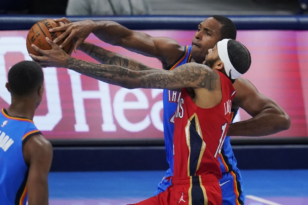New Orleans Pelicans forward Brandon Ingram, front right, drives past Oklahoma City Thunder's Al Horford, rear right, in the first half of an NBA bask...