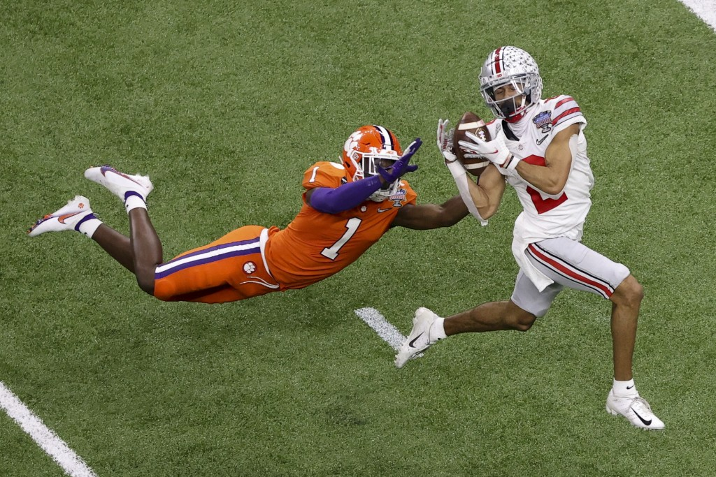 Ohio State wide receiver Chris Olave catches a touchdown pass in front of Clemson cornerback Derion Kendrick during the second half of the Sugar Bowl ...