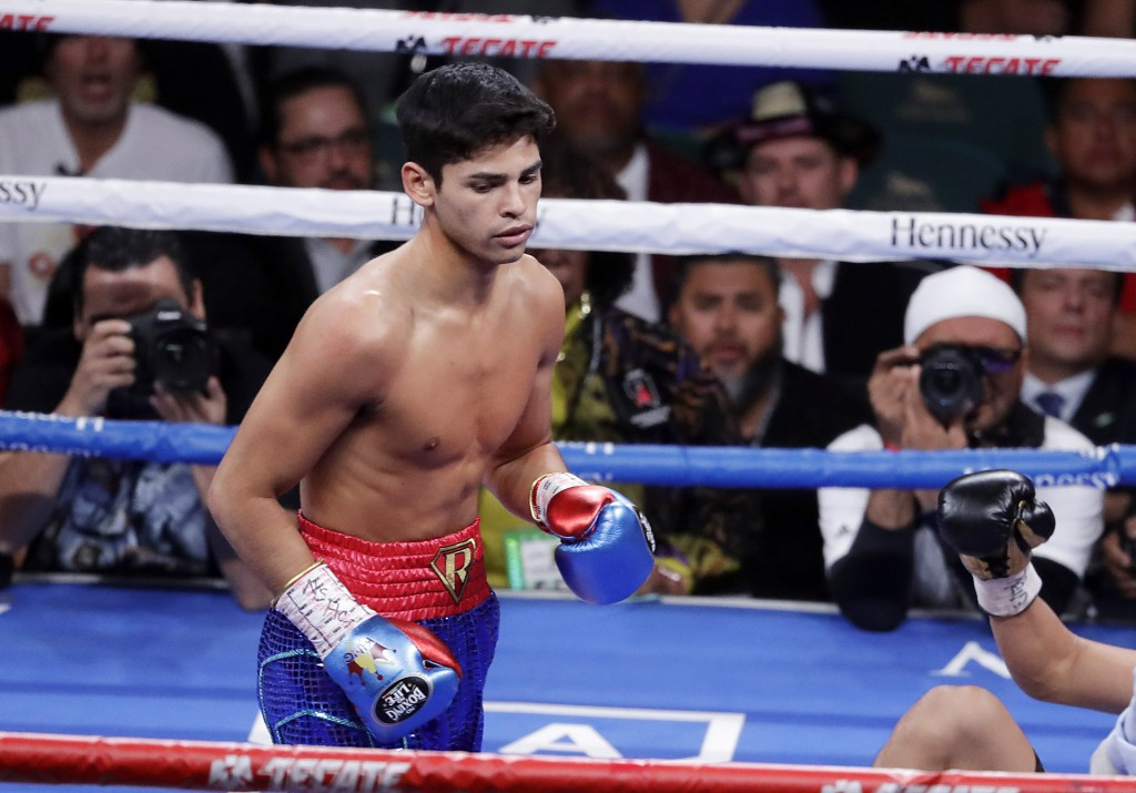 FILE - In this Nov. 2, 2019 file photo, Ryan Garcia, looks on after landing a punch to Romero Duno (not seen) during their lightweight boxing match in...
