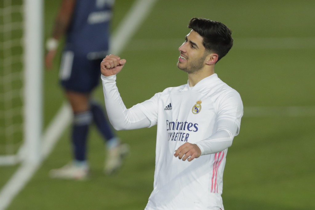 Real Madrid's Marco Asensio celebrates after scoring his side's second goal during the Spanish La Liga soccer match between Real Madrid and Celta Vigo...