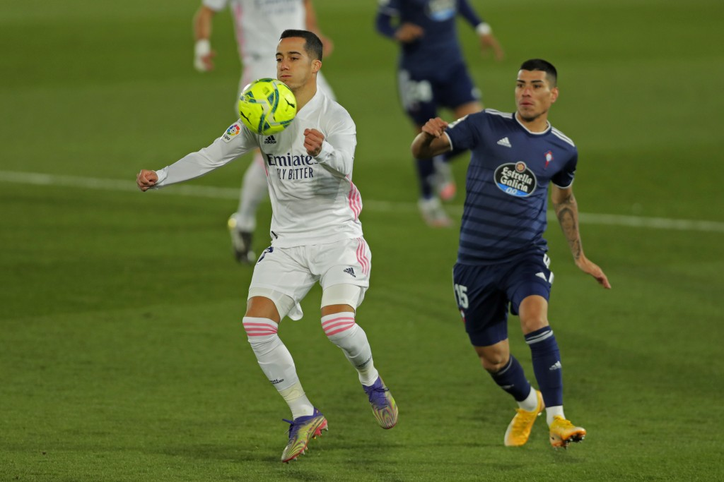 Real Madrid's Lucas Vazquez, left, vies for the ball with Celta Vigo's Lucas Olaza during the Spanish La Liga soccer match between Real Madrid and Cel...