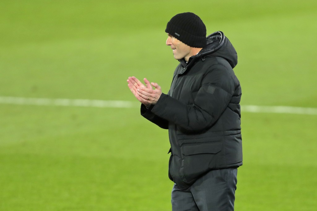Real Madrid's head coach Zinedine Zidane gestures as he follows the action during the Spanish La Liga soccer match between Real Madrid and Celta Vigo ...