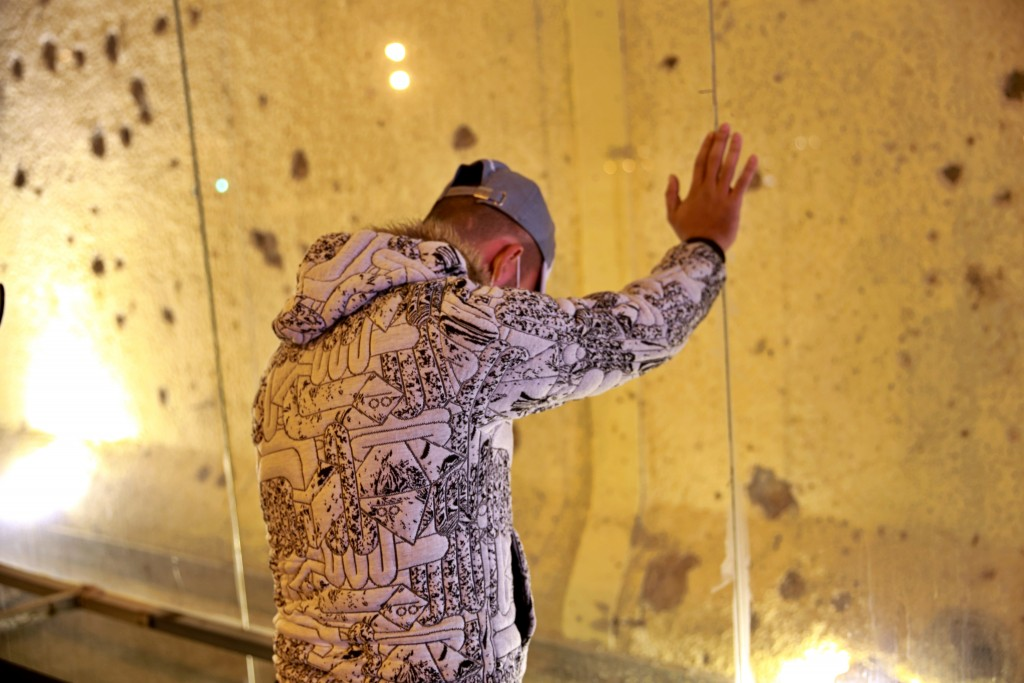 A man grieves at the site of last year's U.S. airstrike at Baghdad's international airport on Saturday, Jan. 2, 2021, on the anniversary of the killin...