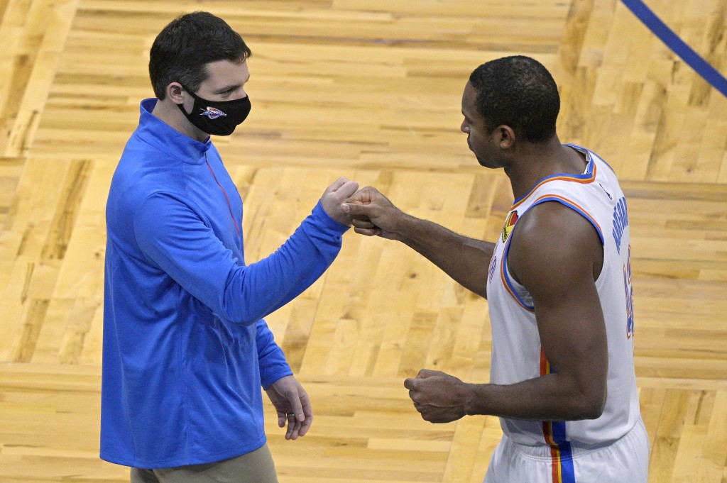 Oklahoma City Thunder head coach Mark Daigneault, left, and center Al Horford exchange fist-bumps prior to an NBA basketball game against the Orlando ...