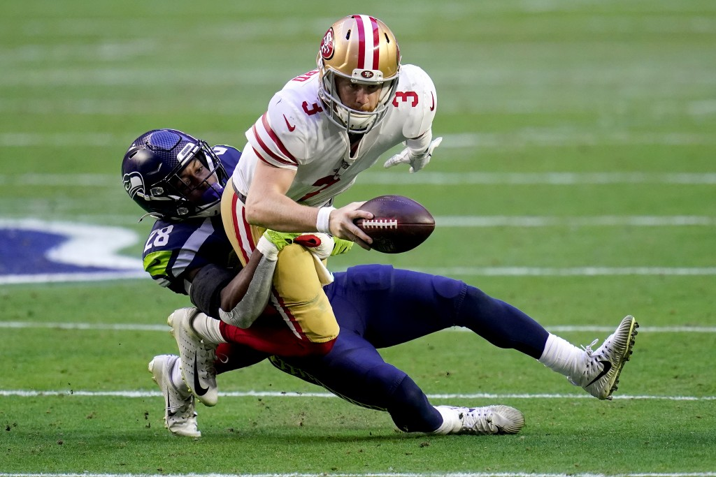 San Francisco 49ers quarterback C.J. Beathard (3) is sacked by Seattle Seahawks safety Ugo Amadi (28) during the first half of an NFL football game, S...