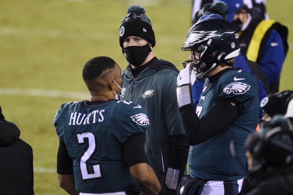 Philadelphia Eagles' Jalen Hurts, from left, Carson Wentz and Nate Sudfeld talk during the second half of an NFL football game against the Washington ...