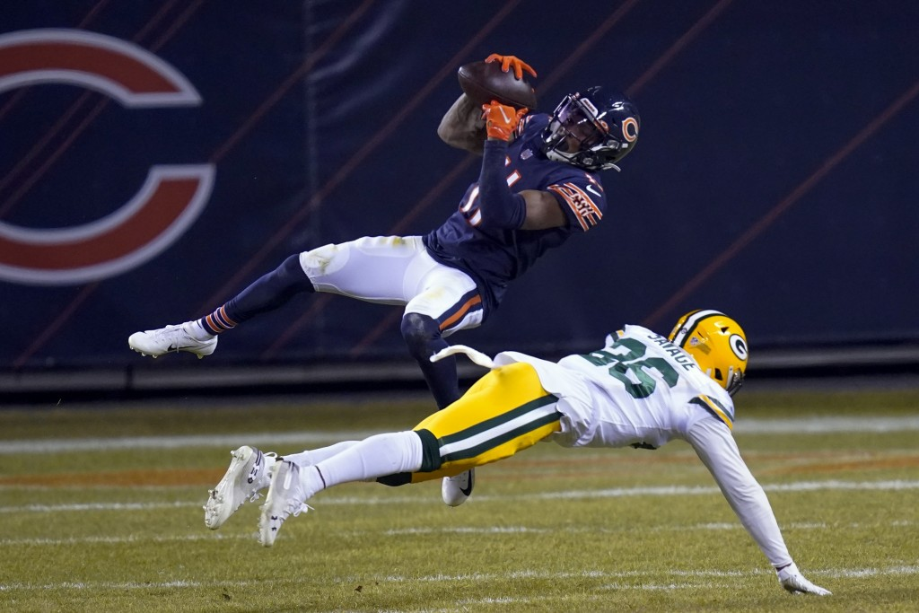 Chicago Bears' Darnell Mooney catches a pass in front of Green Bay Packers' Darnell Savage during the second half of an NFL football game Sunday, Jan....