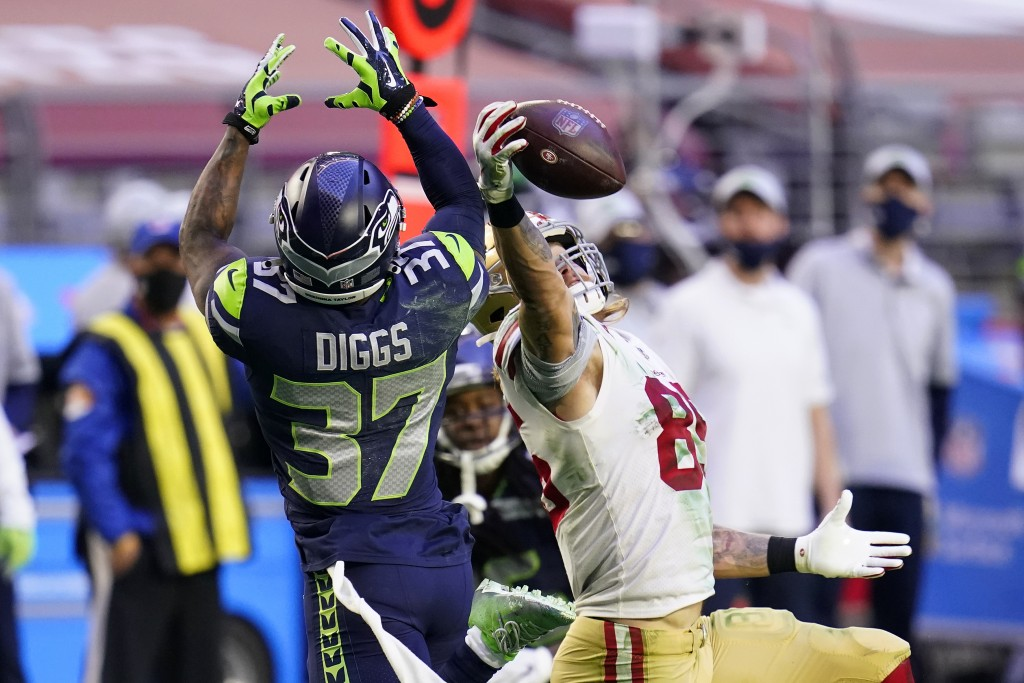 San Francisco 49ers tight end George Kittle (85) makes a catch as Seattle Seahawks free safety Quandre Diggs (37) defends during the second half of an...