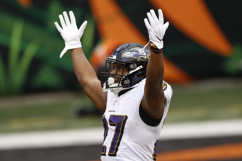 Baltimore Ravens running back J.K. Dobbins (27) celebrates after scoring a touchdown against the Cincinnati Bengals during the second half of an NFL f...