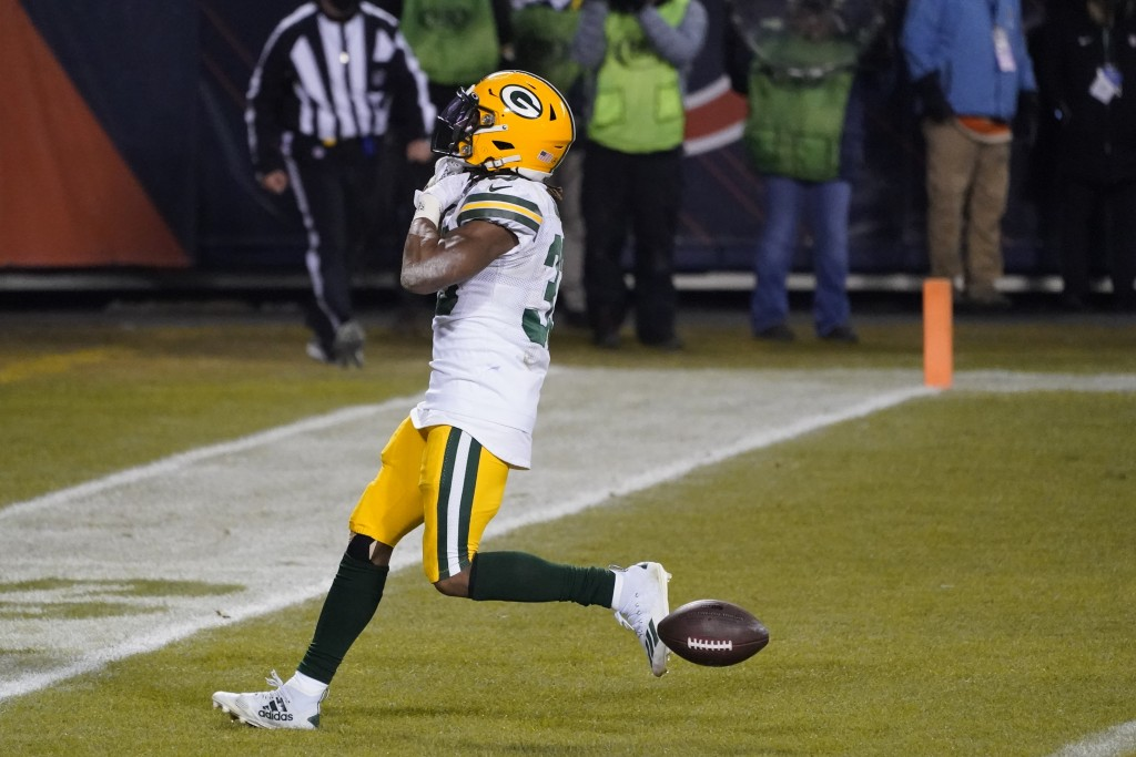 Green Bay Packers' Aaron Jones reacts after running for a touchdown during the second half of an NFL football game against the Chicago Bears Sunday, J...