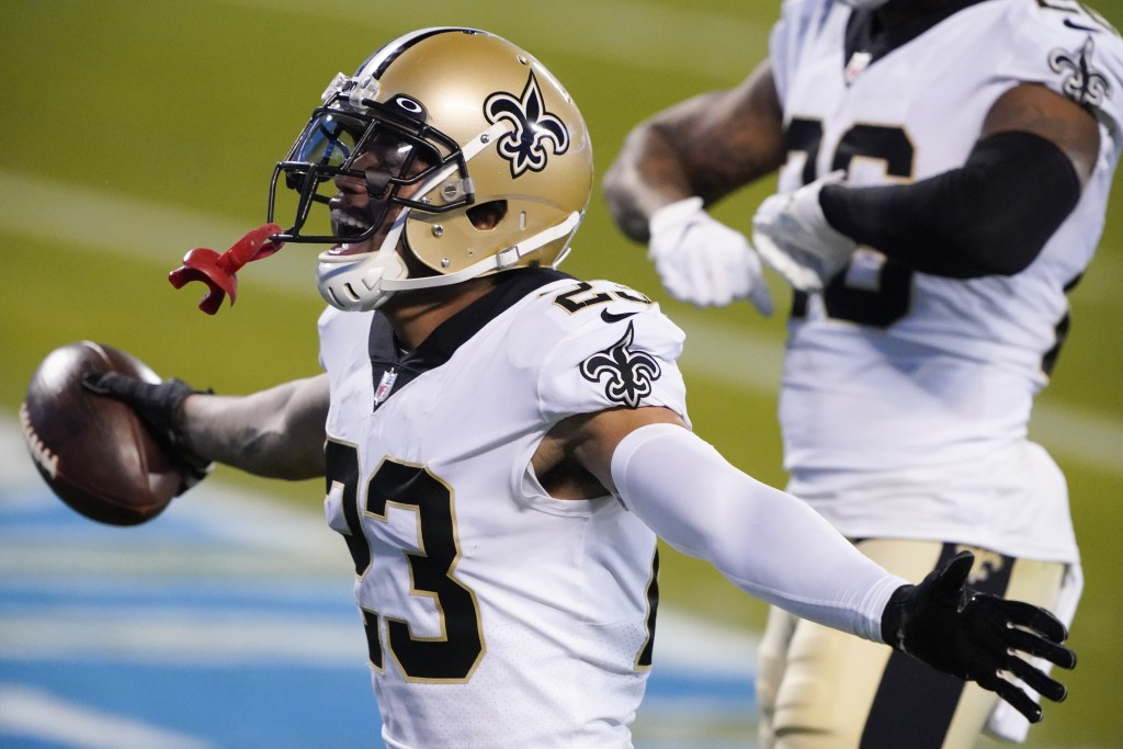 New Orleans Saints cornerback Marshon Lattimore celebrates after an interception during the second half of an NFL football game against the Carolina P...