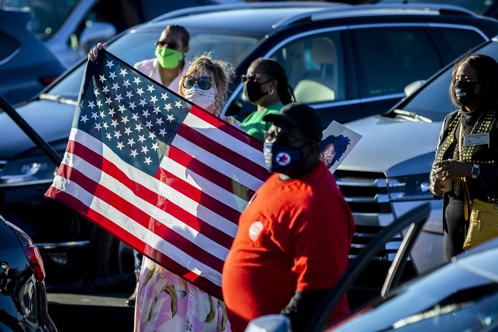 Supporters wait for Vice President-elect Kamala Harris attend a drive-in rally in Savannah, Ga. during a campaign stop for Democratic U.S. Senate chal...