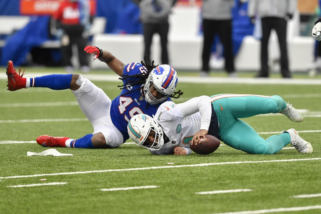 Miami Dolphins quarterback Tua Tagovailoa (1) is sacked by Buffalo Bills middle linebacker Tremaine Edmunds (49) in the first half of an NFL football ...