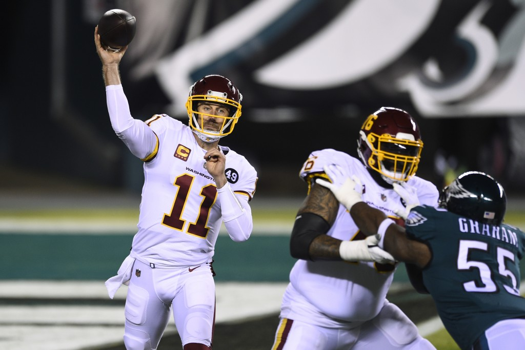 Washington Football Team's Alex Smith plays during the first half of an NFL football game against the Philadelphia Eagles, Sunday, Jan. 3, 2021, in Ph...