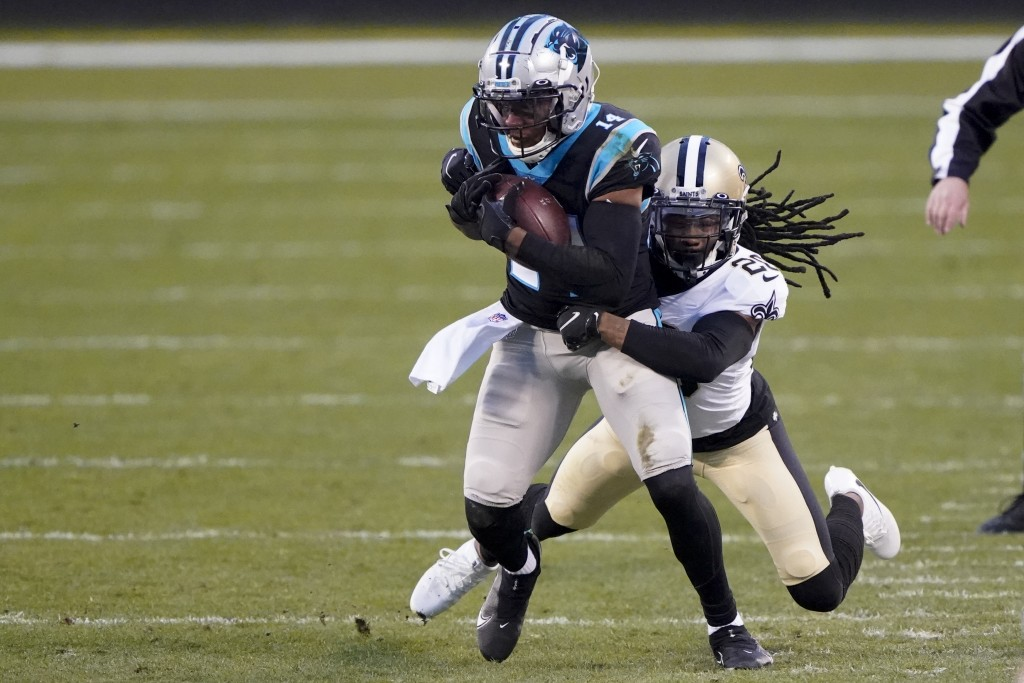 Carolina Panthers wide receiver Pharoh Cooper is tackled by New Orleans Saints cornerback Janoris Jenkins during the first half of an NFL football gam...
