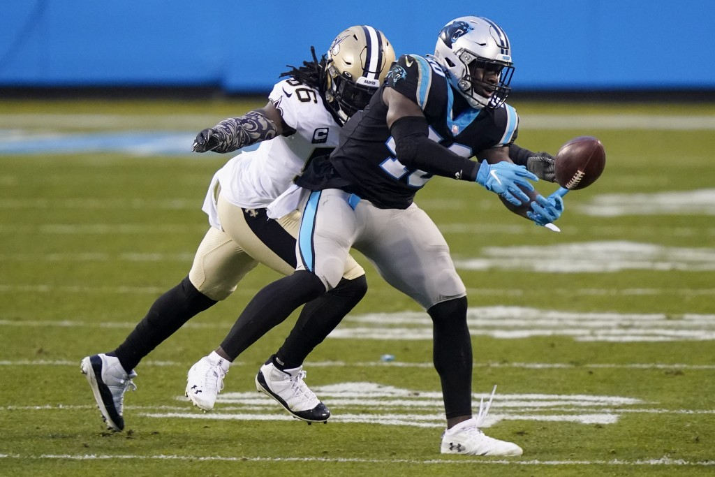 New Orleans Saints outside linebacker Demario Davis breaks up a pass intended for Carolina Panthers fullback Alex Armah during the first half of an NF...